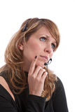Thoughtfull telephone operator Royalty Free Stock Image
