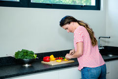 Thoughtfull woman preparing vegetables for dinner Stock Image