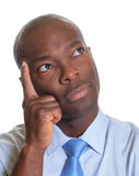 Thoughtfully african businessman Stock Photo