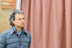 Thoughtfully  class man in gray jacket Royalty Free Stock Image