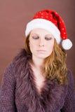 Thoughtfully Female Santa Stock Photography