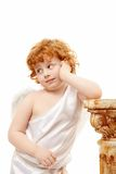 Thoughtfulness. Thoughtful small cupid on a white background Stock Image
