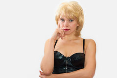 Thoughtfulness. Portrait of the young attractive woman in a wig which shows thoughtfulness Royalty Free Stock Image