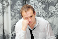 Thoughtfulness at work. Man sitting in shirt thinking Stock Photography