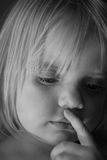 Thoughts. Desaturated image of a child thinking about something stock photography