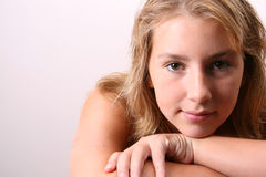 Thoughts. Teenage female model on a white background Royalty Free Stock Image