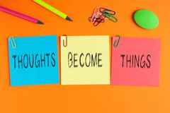 Thoughts Become Things. Written on color notes with and office supplies stock photos
