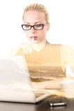 Of thoughts business woman in office, day dreaming. Royalty Free Stock Photo