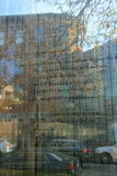 Thoughts from survivors of The Holocaust etched on section of glass,Boston,Massachusetts,Fall,2013. Glass section of towers in Holocaust Garden, etched with royalty free stock photos