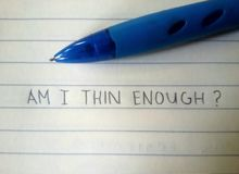 Thoughts written on a paper. Possible thoughts of someone with eating disorder. Am I thin enough Royalty Free Stock Image