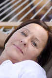 Thougtful mature woman on hammock Royalty Free Stock Images