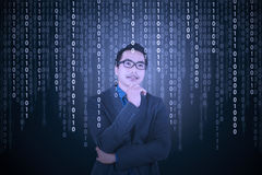 Thougthful businessman with binary code Stock Photos