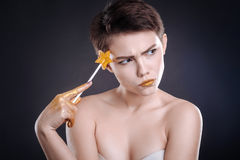 Thouhtful woman posing with lollipop Stock Photography