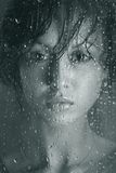 A thousand beautiful things - 2. The beautiful girl behind wet glass Stock Image
