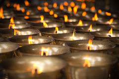 Thousand candles. Burning on the temple Royalty Free Stock Image