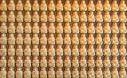 Thousand golden buddha sculpture Royalty Free Stock Images