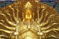 Thousand hands Kuan yin Buddha in Thai temple . Stock Photo