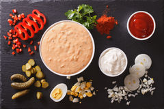 Thousand Island Dressing with ingredients. Horizontal top view Stock Photo
