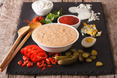 Thousand Island Dressing with ingredients on the slate board Royalty Free Stock Photos