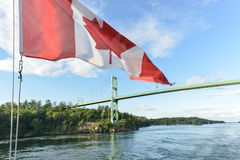 The Thousand Islands Bridge and Canadian Flag Stock Photos