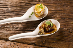 Thousand-leaf sweet potatoes, Pork tongue, ground banana, Marsala reduction. Water meal and Mini watercress in a spoon. Taste gastronomy fingerfood Stock Image
