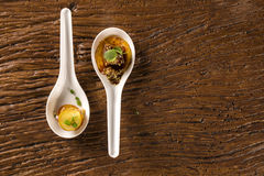 Thousand-leaf sweet potatoes, Pork tongue, ground banana, Marsala reduction. Water meal and Mini watercress in a spoon. Taste gastronomy fingerfood Stock Photos