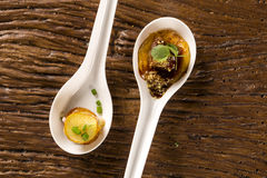 Thousand-leaf sweet potatoes, Pork tongue, ground banana, Marsala reduction, water meal and Mini watercress in a spoon. Taste gastronomy fingerfood Stock Images