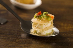 Thousand leaves stuffed with cod vinaigrette and heart of palm in a spoon. Taste gastronomy finger food Stock Photo