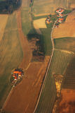 A thousand miles away. Houses and farms, fields and roads as seen from above Stock Photos