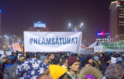 Thousand people marched through the Romanian capital on Wednesday night to protest the government`s plan to pardon thousands of pr. Bucharest, Romania - January Royalty Free Stock Photos