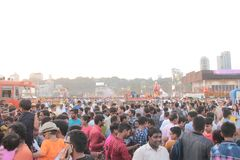 Mumbai people gather on marine drive shore. Thousand of residents of mumbai come to sea coast near girgaon chaupati for immersion of lord ganesh idol immersion royalty free stock photography