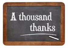 A thousand thanks on blackboard. A thousand thanks. Text on a vintage slate blackboard Stock Photo