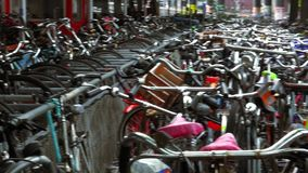 Thousands of bicycles at the biggest Amsterdam bike parking lot City of Amsterdam stock footage
