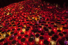 Thousands of Candles illuminating a cemetery during  All Saint's Day Stock Photos
