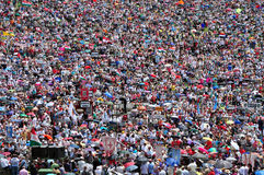 Thousands of Catholic pilgrims praying in the outdoors during th Royalty Free Stock Image