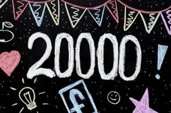 20 thousands chalk drawing on blackboard royalty free stock photography