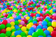 Thousands of colorful plastic balls. Children`s entertainment in balls Royalty Free Stock Photos