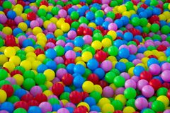 Thousands of colorful plastic balls. Children`s entertainment in balls Royalty Free Stock Photo