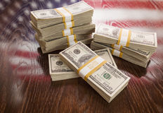 Thousands of Dollars with Reflection of American Flag on Table Royalty Free Stock Photography