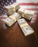 Thousands of Dollars with Reflection of American Flag on Table Stock Photo