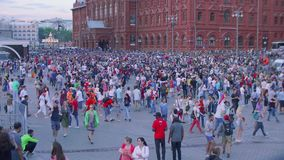 Thousands of fans in centre of Moscow celebrating victory of Russian football team. During Russia vs Spain match stock video