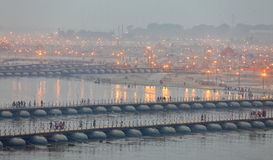 Thousands of Hindu devotees crossing the pontoon bridges over the Ganges River at Maha Kumbh Mela festival Royalty Free Stock Photos