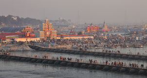 Thousands of Hindu devotees crossing the pontoon bridges over the Ganges River at Maha Kumbh Mela festival Royalty Free Stock Images