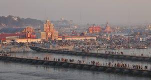 Thousands of Hindu devotees crossing the pontoon bridges over the Ganges River at Maha Kumbh Mela festival Royalty Free Stock Images