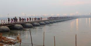 Thousands of Hindu devotees crossing the pontoon bridges over the Ganges River at Maha Kumbh Mela festival Royalty Free Stock Image