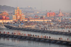 Thousands of Hindu devotees crossing the pontoon bridges over the Ganges River at Maha Kumbh Mela festival Stock Photos