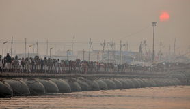 Thousands of Hindu devotees crossing the pontoon bridges over the Ganges River at Maha Kumbh Mela festival. ALLAHABAD, INDIA - FEBRUARY 12, 2013: Thousands of stock photography