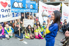 Thousands Junior doctors protest in London. LONDON, UK - OCTOBER 17, 2015: Thousands Junior doctors marching in London streets to campaign against NHS contract Stock Image