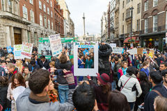 Thousands Junior doctors protest in London. LONDON, UK - OCTOBER 17, 2015: Thousands Junior doctors marching in London streets to campaign against NHS contract Royalty Free Stock Photo