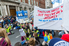 Thousands Junior doctors protest in London. LONDON, UK - OCTOBER 17, 2015: Thousands Junior doctors marching in London streets to campaign against NHS contract Stock Photo